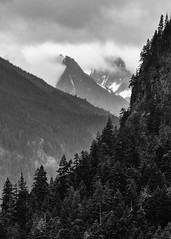 A Mountain Song (John Westrock) Tags: landscape nature blackandwhite monochrome mountains trees clouds cloudy overcast vertical canoneos5dmarkiii canonef100400mmf4556lisusm northcascades diablolake pacificnorthwest washingtonstate johnwestrock