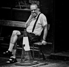 Happy Hour (Neil. Moralee) Tags: neilmoralee neilomoralee man old mature pub drink drinker beer wine spirit cone traffic shorts braces beard sandles socks bench seamus odonells bristol face thinking drunken alcohol alcoholic problem worry desparate black white bw bandw blackandwhite street candid mono monochrome olympus omd em5 neil moralee people happy hour booze