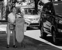 Board (Beegee49) Tags: woman young filipina ironing board traffic city philippines street talisay