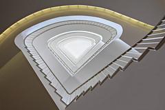 The yellow line (Elbmaedchen) Tags: staircase stairwell stairs treppenhaus stufen escaliers escaleras architektur architecture interior triangle line curves upstairs roundandround office building berlin
