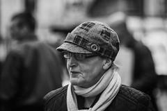 Lady with a patchwork cap (Frank Fullard) Tags: frankfullard fullard candid street portrait black white blackandwhite monochrome patchwork cap ballinasloe galway irish ireland fashion scarf
