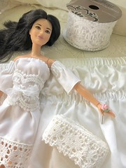 I repurposed a thrift store dust ruffle to make this dress. I used the gathered elastic at the top for the sleeves. Cheap Walmart lace for the corset and another lace for the hem. Im definitely going to keep my eye out for smaller scale lace now. (JunqueDollBoutique) Tags: handmade miniature sewing doll clothing dress lace white romantic diy instructions upcycled repurposed barbie fashion playscale 16