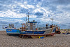 Cougar (Geoff Henson) Tags: boats fishing beach sea ocean sky clouds lighthouse tractor bulldozer boxes floats