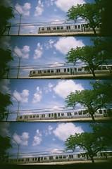 Train (Crawford Brian) Tags: lomography supersampler lomo toycamera plastic film cta chicagotransitauthority el elevated train sky tree movement quadcam four analog kodakcolor400 oakpark illinois expired