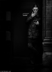 Backdoor Man (Neil. Moralee) Tags: alnwick2018neilmoralee neilmoralee backdoor door back black white man smoke cigarette tobaco portrait dark sinister risk bw blackandwhite mono monochrme contrast harsh criminal boy youth wet raining doorway stonework street candid alnwick northumberland vulnerable vulnerability security exploit attack spy spying watch watcher cultofthedeadcow backoffice bandw olympus omd em5 neil moralee uk