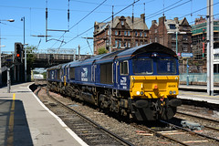 2018-07-03 @ Carlisle: 1246 Carlisle NY - Crewe Basford Hall SSM: 66428 66426 [DSC_3081] (graeme9022) Tags: class 66 664 type 5 general motors gm diesel electric loco locomotive engine uk train citadel station drs direct rail services blue livery plain standard north west england northern border city midland region wcml coast main line mainline settle route freight railfreight railways british shed new yard