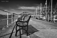 "Queensferry (""A.S.A."") Tags: queensferry river forth edinburgh lothian scotland britain bench rail bridge harbour boat sky cloud sonya7rmkii sony2470f28gm blackwhite mono monochrome greyscale niksoftware silverefex asa2018"