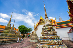 Woman traveler in Wat Pho at Bangkok Thailand. Traveling in Bangkok Thailand (MongkolChuewong) Tags: asia background backpack bag bangkok beautiful chinese city concept female girl grand guy happy hat hipster keaw location looking map outdoor outdoors palace people pho phra popular relax road search space temple thai thailand tour tourism tourist travel traveler traveller travelling trip unseen urban vacation vintage visit wat woman women