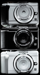 Olympus Pen E-PL1. whte silver black. . . (CWhatPhotos) Tags: cwhatphotos photographs photograph pics pictures pic picture image images foto fotos photography artistic that have which contain olympus epl1 pen original colors colours black white silver bodycap lens body cap three together micro four thirds 43 system