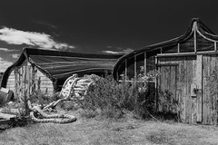 Boat Sheds and Rope (alan.dphotos) Tags: beach rock sand sea shore northumbria landscape boats rope lobster building harbour sky grass monochrome blackwhite upturned