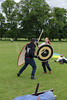 Historia Normannis Meadows June 2018-789 (Philip Gillespie) Tags: historia normannis central scotland sparring fighting shields swords axes spears park grass canon 5dsr men man women woman kids boys girls arms feet hands faces heads legs shins running outdoor tabards chain mail chainmail helmets hats glasses sun clouds sky teams solo dead act acting colour color blue green red yellow orange white black hair practice open tutorial defending attacking volunteer amateur kneeling fallen down jumping pretty athletic activity hit punch