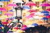 Streetlamp - Genova, Italy (Sebastian Bayer) Tags: installation gasse schirm lampe kunst farbe laterne fluchtpunkt bunt schirme strasenlampe italien genua regenschirm dekoration strase