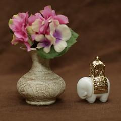 Still Life (N.the.Kudzu) Tags: tabletop stilllife thai vase pottery elephant perfume bottle canon70d manualfocus primelens zenitar50mmf12 flash