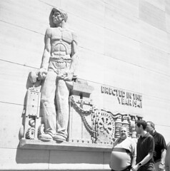 1941 (kaumpphoto) Tags: sculpture rolleiflex tlr 120 bw black white contrast minneapolis urban city street work worker workers bright shadow 1941 labor stone carve block wall chain hammer chest hat cap gear pliers anvil belt gut belly stripe watch abs relief reliefsculpture tool tools