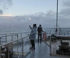 Weathering the storm. (jenichesney57) Tags: boatfiordland nzpeoplegreywaterwaterfallswetviewpanasoniclumixtripholidayautumn snow mountains deck stormy waves atmospheric
