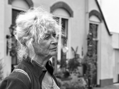 Portrait of Hester (d_t_vos) Tags: portrait woman oldwoman face sideview side grey greyhair oldage beautyofage wrinkles pilgrim santiagoaanhetwad caminoderlagelanden camino doesburg outside streetphotography streetportrait street availablelight dof mulier dickvos dtvos