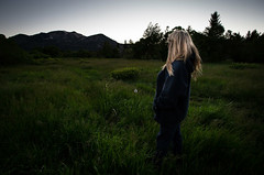 Her Meadow (CameraOne) Tags: canon6d canonef1740 wideangle dusk sunset meadow moody mountains raw female blonde woman she her backlit dark green wildflowers summer cameraone