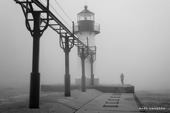 Solitary Fisherman (mswan777) Tags: 1855mm nikkor d5100 nikon white black blackwhite ansel tower structure water weather lakemichigan coast shore seascape nature outdoor silhouette solitary fisherman mist fog lighthouse pier