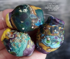 Rocks Teal Aqua Purple Ocher Silvered (Laura Blanck Openstudio) Tags: openstudio openstudiobeads glass handmade lampwork murano fine art arts artist artisan beads set opaque matte frosted etched glow glowing rocks nuggets pebbles stones whimsical funky odd abstract asymmetric speckles frit raku sterling silver silvered yellow ocher apple teal emerald rainforest pine mustard suede bright bold lilac lavender purple violet eggplant mauve grape aqua turquoise blue honey colorful multicolor