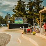 People outside watching a football match on big screen (public viewing) thumbnail