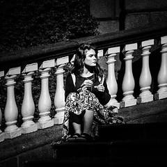 Pawns (Kieron Ellis) Tags: woman pillars street candid bright blackandwhite blackwhite monochrome steps sitting dress
