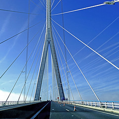 Pont de Normandie - France (pom'.) Tags: rn1029 estuairedelaseine pontdenormandie may 2018 panasonicdmctz101 haze sky clouds bridge river seine seinemaritime 76 lehavre road roadpicture fromamovingvehicle normandie france europeanunion 100 200 300
