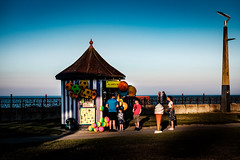 All Sorts (Kieron Ellis) Tags: icecream shop stall sea woman children man balls shadows sky bluesky candid street colour