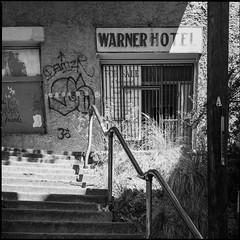 Warner Hotel (greenschist) Tags: grafitti usa warnerhotel steps 6x45 cochisecounty mediumformat film analog blackwhite arizona zenzanonrf65mmf4 bronicarf645 bisbee ilforddelta100