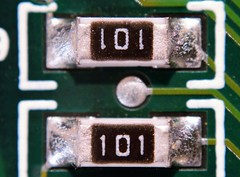#Twins -   Resistance ;)HMM! (Jon Hughes2) Tags: flickrfridays twins nikond3100 nikonpb4bellows nikkor50mms14 macro macromondays insideelectronics fun