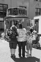 Difficult Decisions - Which Ice Cream to Purchase (DJ Wolfman) Tags: muskegon street blackandwhite bw people streetphotography streetphoto streetscene michigan artfestival sony a7markii