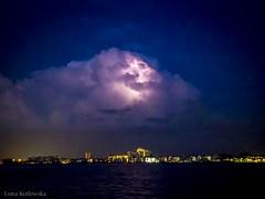 Heat lightning (LonaKot) Tags: florida holidays beach sea dusk thunder lightning storm cloud sky water city citylights
