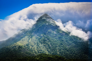 Clouds over a Mountain top on Ngong Ping Lantau Island Hong Kong