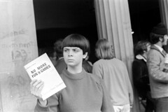 040870 12 (ndpa / s. lundeen, archivist) Tags: nick dewolf nickdewolf blackwhite photographbynickdewolf bw 1970 1970s 35mm film monochrome blackandwhite april cambridge massachusetts mass harvardsquare people woman youngwoman brunette bangs shorthair sweater publication book booklet feminist activist literature nomorefungames journal thedialecticsofsexism ajournaloffemaleliberation femaleliberationfront issuethree issue3 building graffiti brickbuilding column pillar youngpeople cell16 militantfeminist newspaper womensmovement timesup