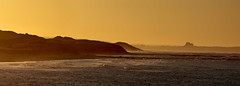 Lindisfarne Sunset (LindaShaws Images) Tags: lindisfarne glowing sunset cloudsstormssunsetssunrises yellow goldencolours waves lighting evening northumberland panorama stunning view castle sea seahouses seaside