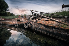 Could use a little paint (bjdewagenaar) Tags: boats ships shipwreck decay rusty photography photograph photographer photooftheday sony sonyalpha sonyphotographer sonyimages sonya77ii sonya sigma wideangle ultrawideangle dutch holland werkendam water reflection sky clouds raw lightroom