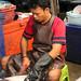 Scaling fish - Mae Klong Railway Market (Talad Rom Hub), Bangkok, Thailand 2018