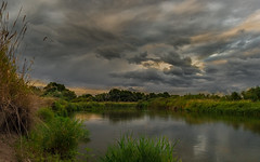 The calm before the storm (piotrekfil) Tags: nature landscape sunset clouds water river sky reflections summer twilight poland pentax piotrfil