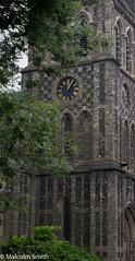 Clock & Tree (M C Smith) Tags: clock church tree green pentax k3 sky blue branches black hedge stone brick numerals arches