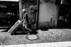 Working at barlonino lake (GPStreepher) Tags: streetphotography street leicaq leica blackandwhite working