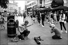 She stoops to photograph - DSCF4598a (normko) Tags: london west end leicester square musician street performer photographer guitarist