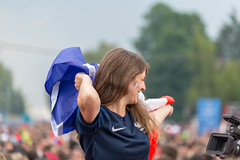French female soccer fan rooting for France during final