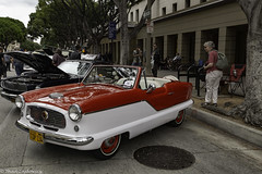 Does she want one? (Thad Zajdowicz) Tags: zajdowicz pasadena california canon eos 5dmarkiii 5d3 dslr digital availablelight lightroom outdoor outside light shadow usa classic car vintage automobile transportation nash metropolitan people color twotone red white street urban city convertible building ef24105mmf4lisusm cute