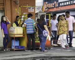 Busy Corner (Beegee49) Tags: street corner snacks men women filipina stall vendor dogs puppies bacolod city philippines