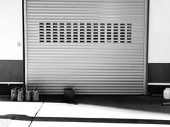 The day may start (frankdorgathen) Tags: smartphone iphone iphone8plus monochrome schwarzweiss schwarzweis blackandwhite banality banal mundane urban licht light shadow schatten sonne sun gasstation tankstelle rolltor rollerdoor rollershutter