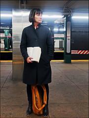 Reader - NYC Subway Platform (TravelsWithDan) Tags: candid streetphotography subway underground metro platform woman book reader nighttime alone canong3x coat winter purse nyc newyorkcity manhattan urban city streetportraits ngc