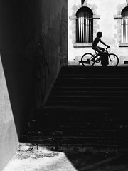 Black and light (Yann Fauchier urban & portrait photography.) Tags: rue street blackwhite fujifilm fuji rennes bretagne cycling bike kid stairs light