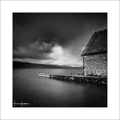 Interlude XV (Frank Hoogeboom) Tags: windermere unitedkingdom uk lakedistrict cumbria england lakes lake britain blackwhite monochrome square longexposure fineart clouds water shed house pier jetty sky dramatic scenic boathouse
