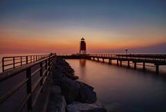 Sundown at the Lighthouse (T P Mann Photography) Tags: lighthouse reflections sea seascape lake michigan charlevoix sunset sundown