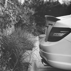 In the Wild (A.C.Bya) Tags: cars bw blacn white carlzeiss exposure film filmisnotdead medium format 6x6 grayscale hasselblad kodak trix monochrome planar reflection stand developed zeiss