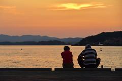 Lake Shinji Sunset Scene (Yohsuke_NIKON_Japan) Tags: shimane lakeshinji matsue sanin d750 nikon nikond750 24120mm lens sunsey zoomlens people 2people couple evening sunsettime lakeside nature orange